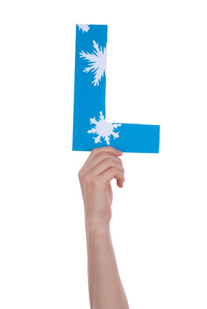 illiterate: A Person holding a L with Snowflakes, Isolated Stock Photo
