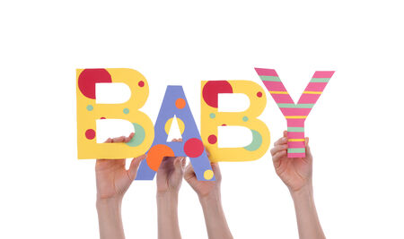 Many Hands Holding the Colorful Word Baby, Isolated photo