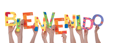 Many Hands Holding the Colorful Spanish Word Bienvenido, Which Means Welcome, Isolated photo