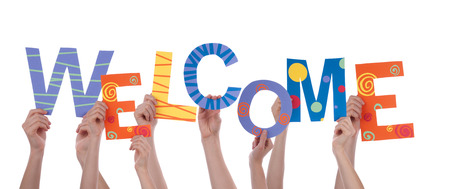 Many Hands Holding the Colorful Word Welcome, Isolated Stock Photo