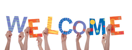 Many People Holding the Colorful Word Welcome, Isolated photo