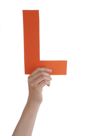 l hand: A Hand Holds the Orange Letter L, Isolated
