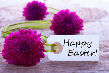 A Tag with Happy Easter and a Purple Green Background photo