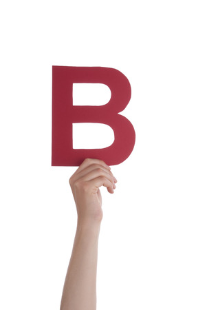 illiterate: A Hand With a Red B in it, Isolated Stock Photo