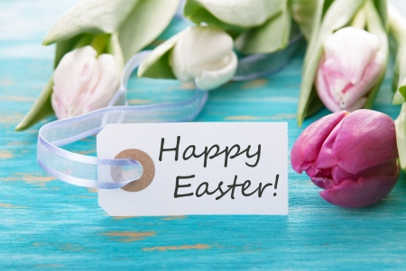 Tag with Happy Easter on a turquoise background with tulip photo