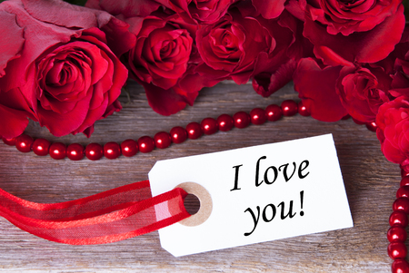 Label with the Word I love you and roses as Background photo