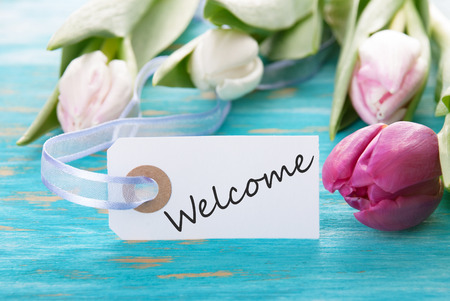 Label with Welcome and Tulip Flowers photo