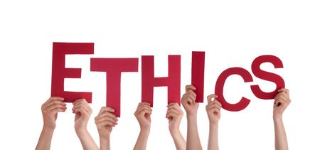 Many Hands Holding the Red Letters Ethics, Isolated photo