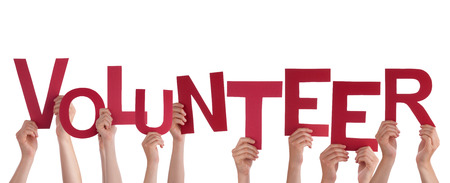 volunteering: Many Hands Holding the red Letters Volunteer, Isolated Stock Photo