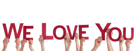 declaration of love: Many People Holding the Red Words We Love You, Isolated