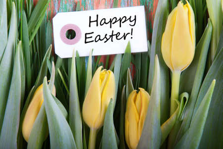 Happy Easter on a Label with Yellow Tulips photo