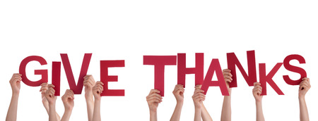 thanks giving: Many Hands Holding the Red Words Give Thanks, Isolated Stock Photo