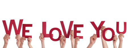 Many Hands Holding the Words We Love You, Isolated Stock Photo