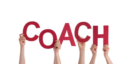 Many Hands Holding the Word Coach, Isolated Stock Photo