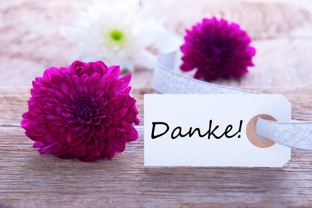 Label with the German Word Danke which means Thanks and Purple Flowers photo