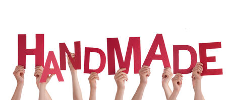 hand crafted: Many Hands Holding the Red Word Handmade, Isolated Stock Photo