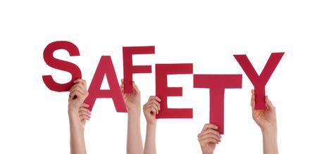 Vele Handen die het rode woord veiligheid, Geïsoleerde Stockfoto