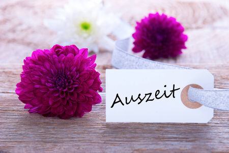 Label with the German Word Auszeit which means Downtime Stock Photo - 26344898