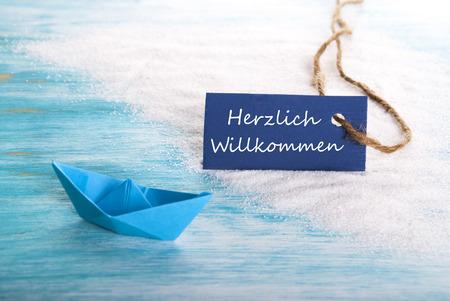 willkommen: Label with the German Word Herzlich Willkommen which means Welcome