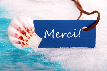 Nautical with Label with the French Word Merci which Means Thanks photo