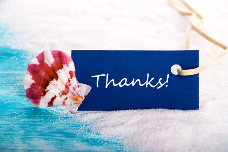 Thanks on a Label at the Beach with Sand and Shell photo