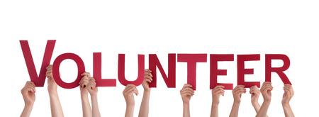 Muchas personas que sostienen la las palabras de Voluntarios, Aislado