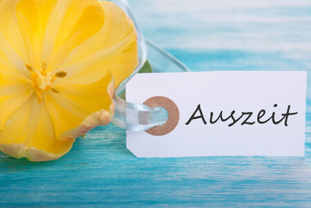 Label with the German Word Auszeit which means Downtime Stock Photo