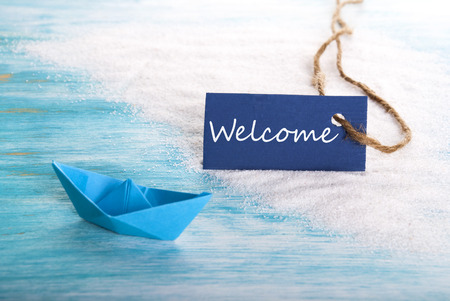 Welcome Label on the Beach with a Boat, nautical Background