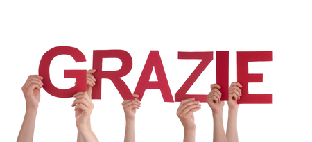Many People Holding the Italian Word Grazie which means Thanks, Isolated photo