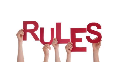 Muchas personas que sostienen la las Reglas de palabras, aisladas Foto de archivo