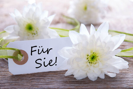 Label with the German Words Fuer Sie which means For You, with white Blossoms photo