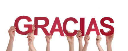 Many People Holding the Spanish Word Gracias, which means Thanks, Isolated photo