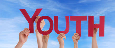 boyhood: Many Hands Holding the Red Word Youth in the Sky