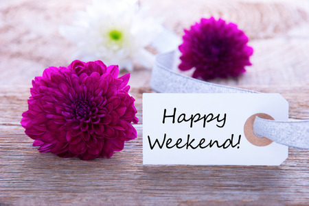 weekend: Label with Happy Weekend and Purple Flowers in the Background