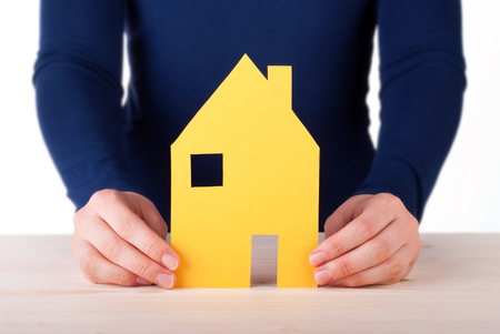 A Woman is Holding a House between her Hands, Isolated photo