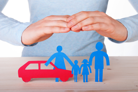 child protection: Hands Guarding a Family with their Car, Isolated