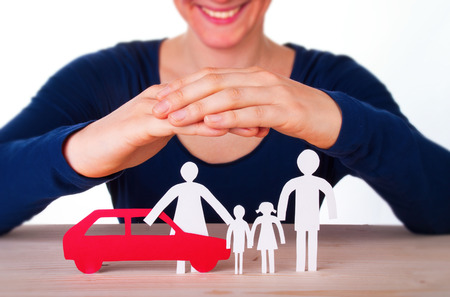 assure: A Woman Protects a Family with their Car, Isolated Stock Photo