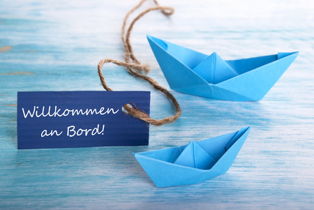 willkommen: Label with the German Words Willkommen an Board which means Welcome on Board