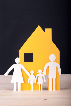 White Paper Chain Family with their House in front of a black photo