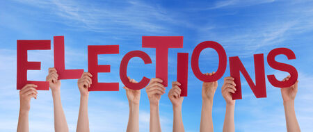 Many Hands Holding the Red Word Elections in the Sky photo