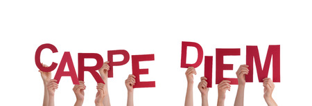 avail: Many Hands Holding the Latin Words Carpe Diem, Isolated Stock Photo
