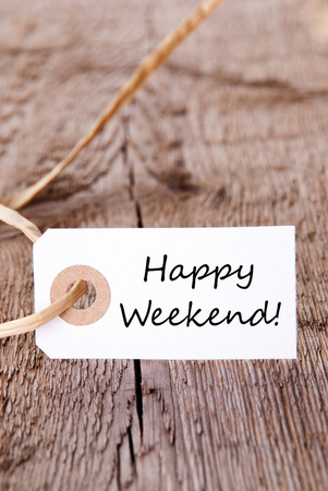 A Natural Looking Label on Wood with the Words Happy Weekende photo
