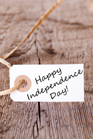 A White Label on Wood with the Words Happy Independence Day photo