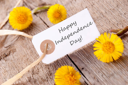 White Banner with Happy Independence Day and Yellow Flowers photo