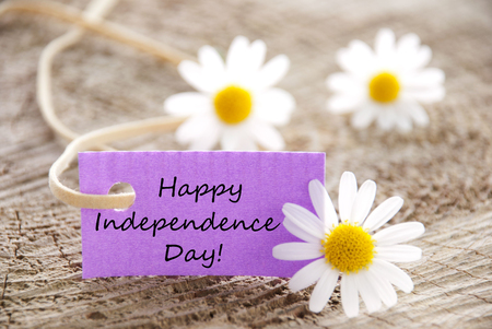 A Purple Label with the Words Happy Independence Day and White Flowers photo