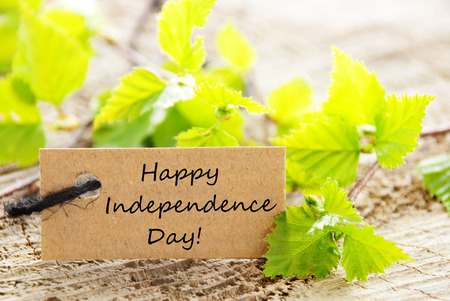 A Natural Looking Label with Green Leaves and the Words Happy Independence Day photo