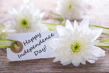 White Flowers with Happy Independence Day on a White Label photo
