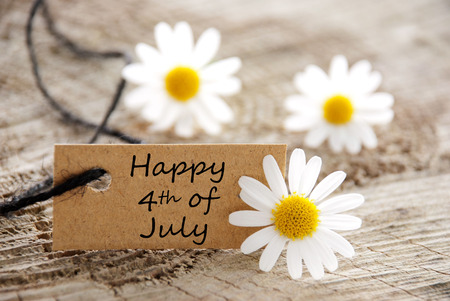 A Natural Looking Label with Happy 4th of July and White Flowers photo