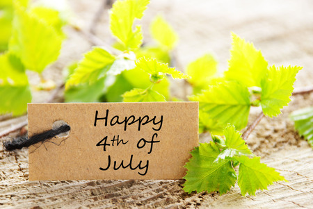 Label with Green Leaves and the Words Happy 4th of July photo