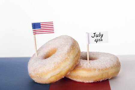 Two Donuts with American Flag and white Banner with July 4th, Isolated photo
